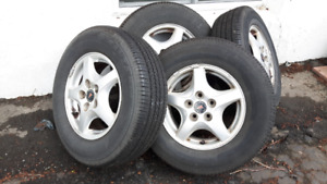 15in Pontiac Mag 5x115  and Tires (11/32, one season)