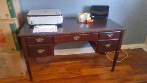 Antique large brown desk for sale with a filing drawer.
