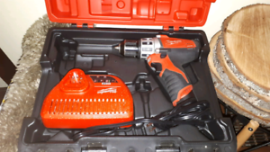 Milwaukee m12 drill , charger and case. No batteries.