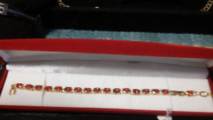 NEW!! Bracelet with reddish stones and small zirconia accent