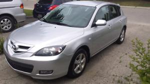 2009 Silver Mazda 3 manual w/ 126000 km