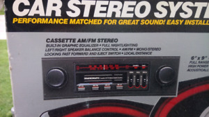 New  never used  am/fm cassette  car stereo with speakers