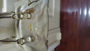 Coach purse for sale worth 400.00 but cleaning out closet
