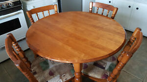 Elegant round dining table with four chairs