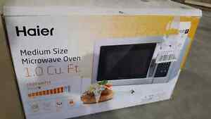Haier stainless still microwave 1.0 Cu. Ft. For sale
