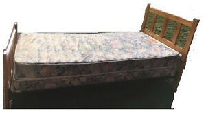 Kid's single bed with mattress and box, $50