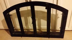 Black Iron Fireplace Insert w/ 2 Bifolding Glass Doors for sale