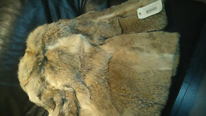 a vendre furrure 100 % natural coyote coat grandeur 10, bon etat