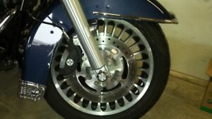 Harley Davidson Touring bike mag wheels with tires.