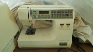 Janome Memory Craft 7000 sewing machine with table