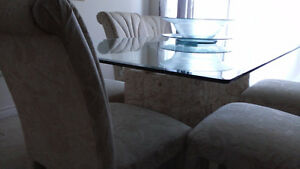 Beautiful glass top table on pedastals with 6 chairs mint shape