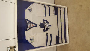 MAN CAVE OR BAR ... Framed leafs jersey ..