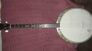 older four stringed banjo