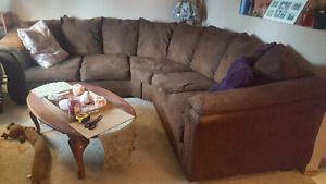 Large brown suede curved sectional sofa