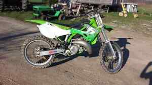 2000 kx125 with ownership! trade for snowmobile!