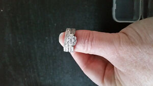 Brand new engagement Silver with white sapphires. ...size 8