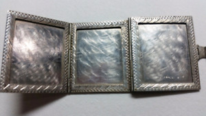 Antique silver pocket picture frame (firm)
