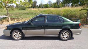 2000 Subaru Outback Limited Edition 2.5L turbo AWD.