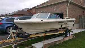 15ft Surfmaster boat with 50hp johnson motor and trailer