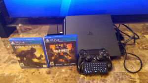 ps4 slim 1tb in perfect conditions+games