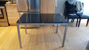 Glass top dinner table for 4 people