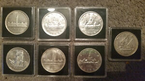 7 very rare silver dollars all in protective cases only 175$.... London Ontario image 1