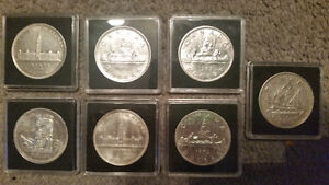 7 very rare silver dollars all in protective cases only 175$....
