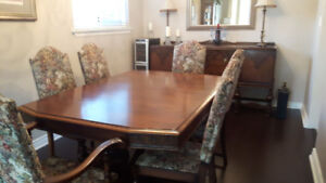 antique wooden dinning room table and chairs