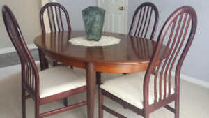Elegant rosewood dining table and 8 chairs for sale