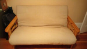 Beige Futon for sale, available immediately $100 obo