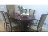 Extendable Italian style dining table with 6 matching chairs.