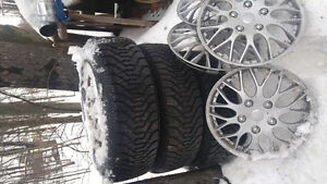 Set of 4..15 inch winter tires on rims