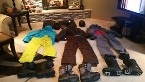 Assorted Snowboard and Ski Jackets, Pants, Helmets and Boots.
