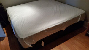 Barely used King mattress with 2 boxsprings