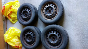 4 used Michelin X-Ice winter tires with steel rims for sale