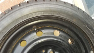 Set of Dunlop graspic ds-2 tires with steel rims size 225/50R16