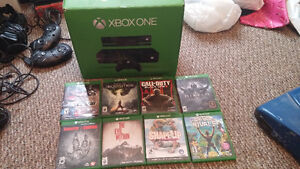 500gb XBOX 1 with kinect, headset and 8 games