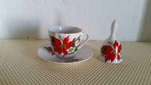 Cup and Saucer and Bell
