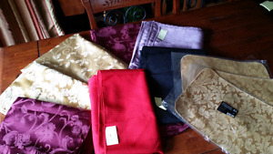 4 table clothes and  6 brand new placemats