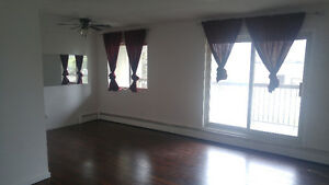 REDUCED PRICE: Spacious 1 Bedroom 1 Block From LRT, BusTerminal