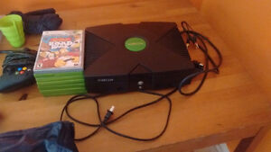 Xbox with all cables, seven games, and controller
