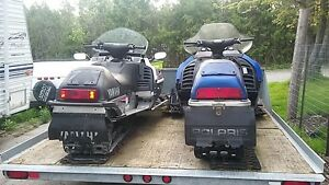 2 snowmobiles and trailer