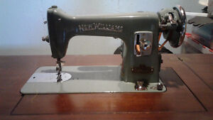 Older sewing machine with cabinet