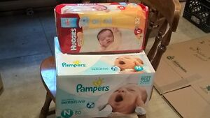 112 N Sized Diapers (unopened packages)