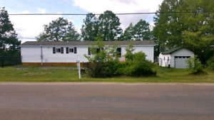 Mini home and garage 25 min from Moncton with land