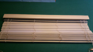 Tan Window blind. 44.5 x 38 inches