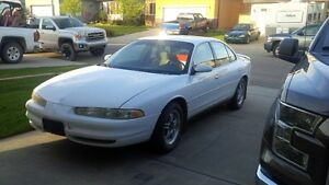 1998 Oldsmobile Intrigue white Sedan