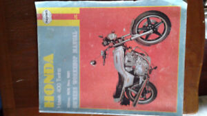 Many motorcycle / car repair manuals some new in plastic still