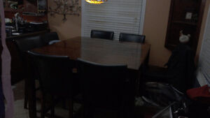 8 chair kitchen table bar height. Can remove middle leaf. 325OBO