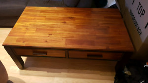 Coffee table with drawers.